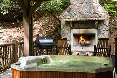 outdoor fireplace and hottub