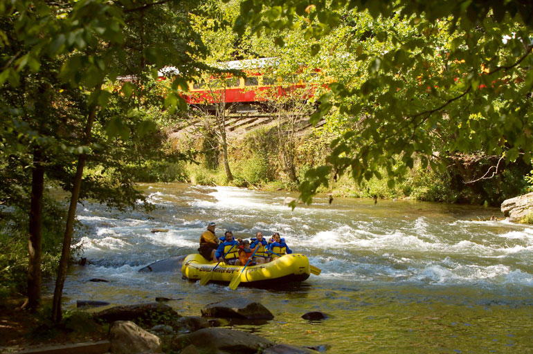 whitewater rafting with train