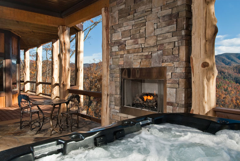covered portch witn hot tub and fireplace