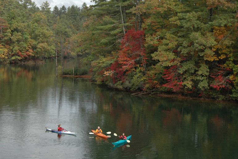 kayaks on lake in fall